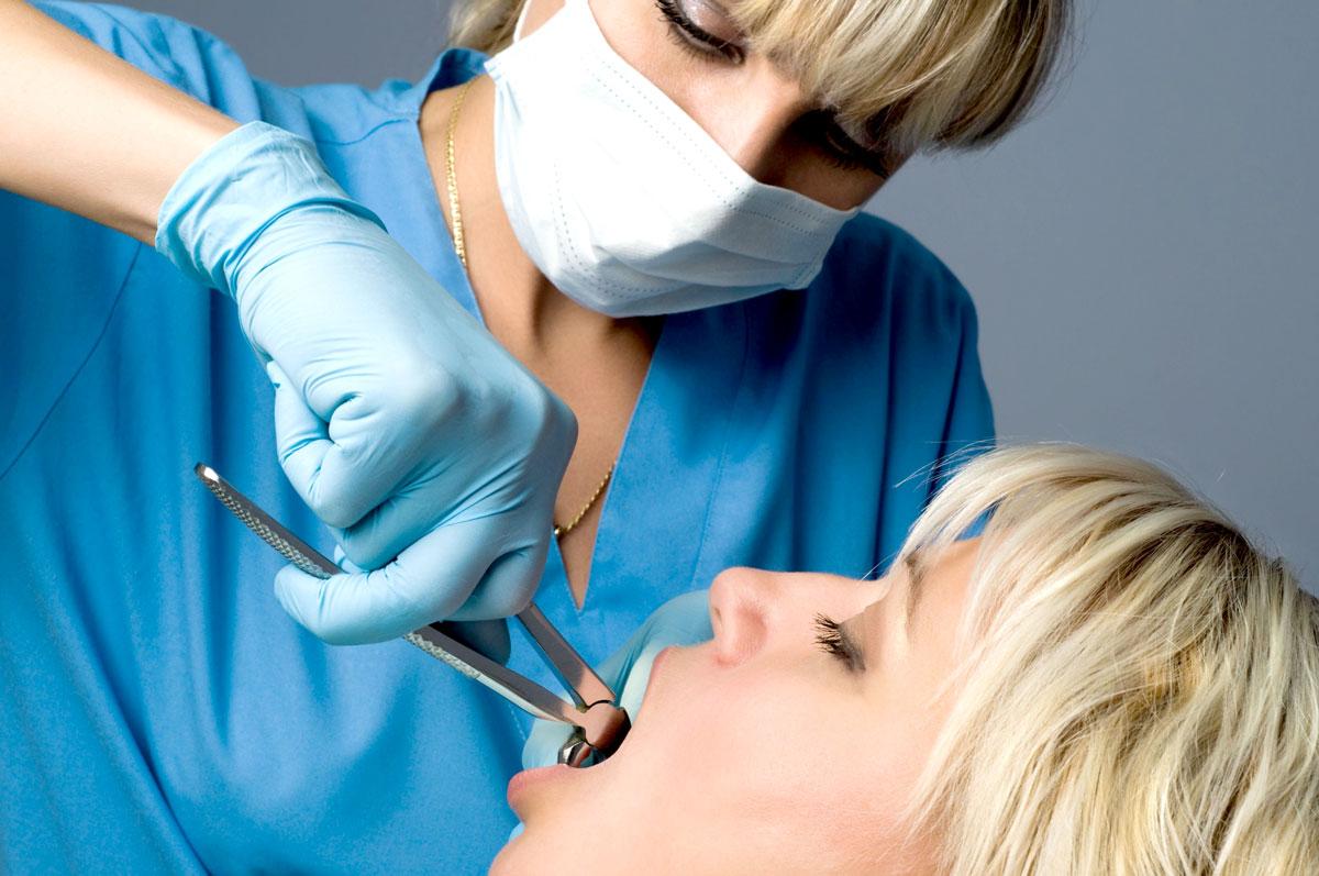 Удаления зуба с брекетами